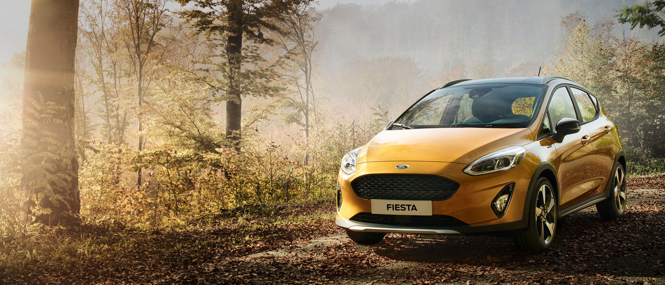 Golden Ford Fiesta Active in the forest