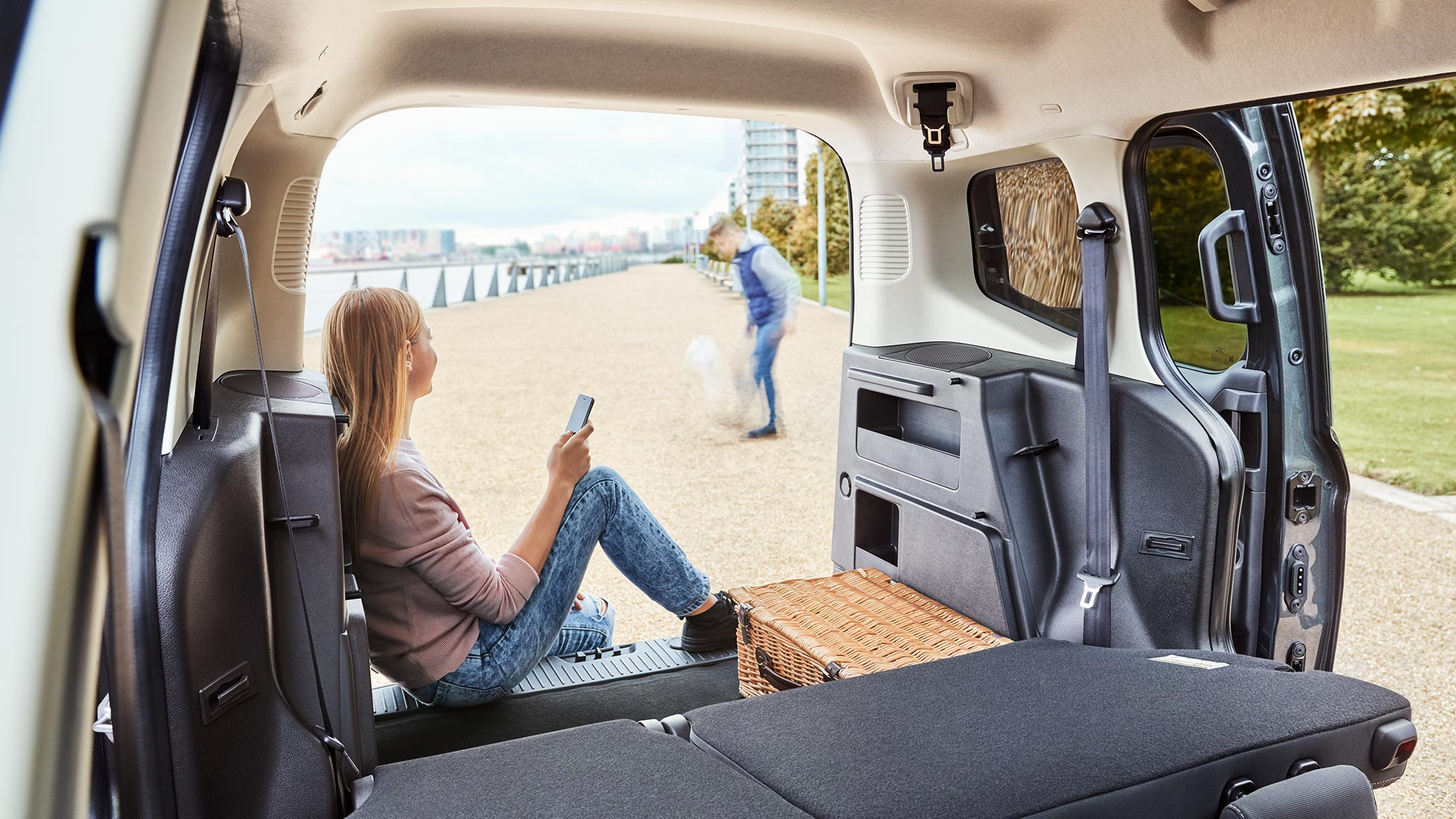 Ford Tourneo Courier interior with a person sitting on a box